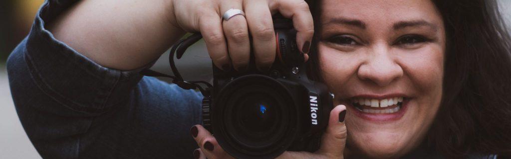 Sarah J. Slover with camera. Photo credit Megan Leiter/Joy Photography.